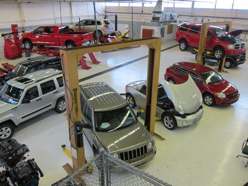 cars inside the automotive building