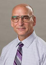 Dr. Mark L. Huson