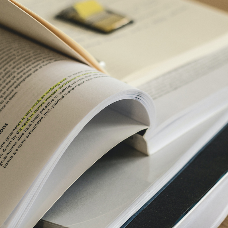 A book opened to show the spine and text.