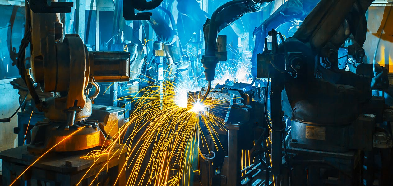 Image of a robotic welders with sparks flying