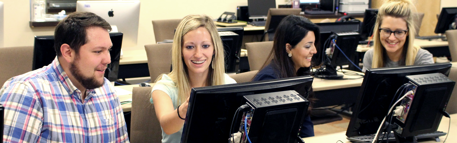 Students work together in a computer lab at Weber State University